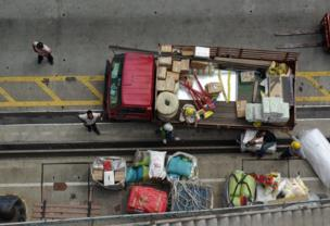 A truck is being loaded with supplies