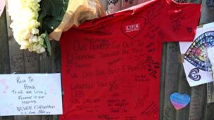 A London Fire Brigade T-shirt is covered in messages