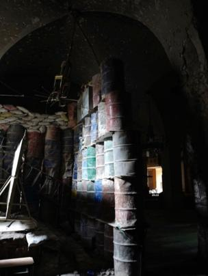 Oil drums piled five-high inside the mosque