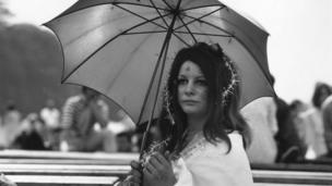 27 August 1967: A flower child with tinsel in her hair during the ' Love-In' at Woburn Abbey, Bedfordshire