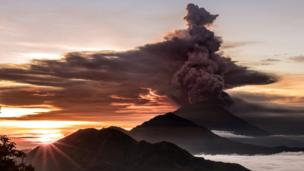 Mount Agung volcano is seen spewing smoke and ash