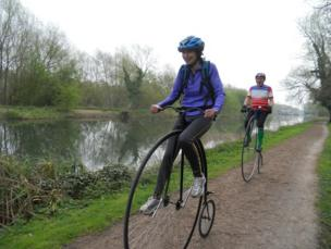 Penny farthing cyclists
