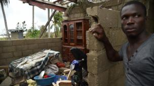 Stanley stands in his destroyed house after the passing of Hurricane Matthew, in Les Cayes, in Southwest Haiti