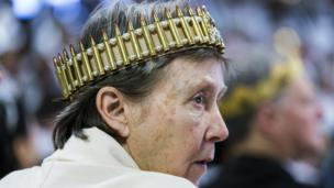 A parishioner with the Sanctuary Church wears a crown of bullets