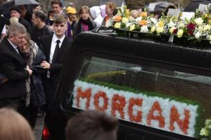 A hearse carrying the coffin of Morgan Barnard