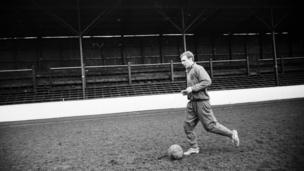 Bobby Moore, England captain, trains on his home ground, in January 1965