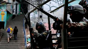 Armed Forces take up position during a operation after violent clashes between drug gangs in Rocinha slum in Rio de Janeiro, Brazil, September 22, 2017.