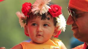 A young girl watches Bengali new year celebrations