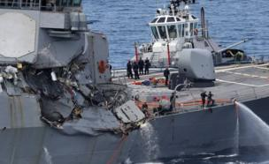 damages on the guided missile destroyer USS Fitzgerald off the Shimoda coast after it collided with a Philippine-flagged container ship