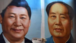 Painted portraitz of Chinese Prezzy Xi Jinpin n' late communist leader Mao Zedong