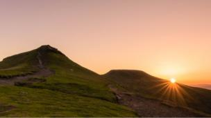 Sunrise at the summit of Pen Y Fan in the Brecon Beacons