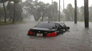 Partially submerged car in flood water