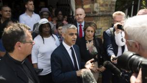 London Mayor Sadiq Khan addresses the media after a service at St Clements Church