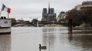 The flooded Seine with Cathedrale Notre-Dame de Paris in the background on 23 January 2018
