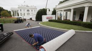 A carpet being cut outside the White House during the renovation work.