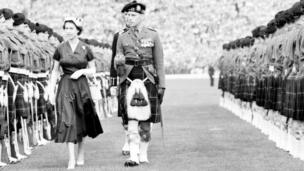 Queen inspects guard of Highland Light Infantrymen at Hampden Park, Glasgow, as one of the events of the Queens Coronation visit to Scotland in 1953