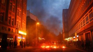 Barricades burn as protesters clash with riot police during the protests at the G20 summit in Hamburg, Germany, July 7, 2017.