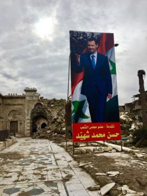 A poster of President Bashar al-Assad at the entrance to the Umayyad mosque