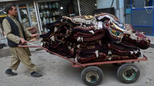 The trade in Afghanistan's famous carpets and rugs has suffered alongside other businesses on Chicken Street with restaurants and sports clubs closing in recent years