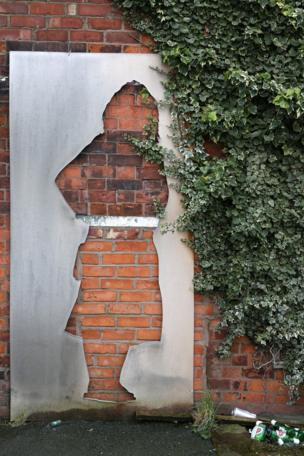 Cut out shape against a wall