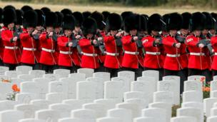 The Irish Guards arrive at the Tyne Cot Commonwealth War Graves Cemetery for the commemorations