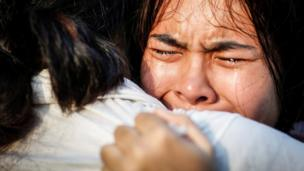 Thai women weep after the death of the king