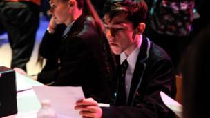 A Young Reporter checking a news script