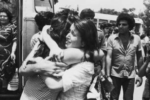 An Israeli hostage is greeted on her return to Israel after Operation Entebbe on 3 July 1976