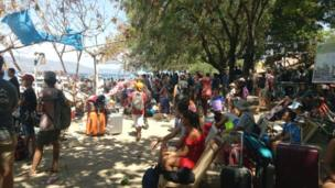 People waiting to evacuate Gili Air, one of the Gili islands