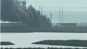 A handout image from a NASA live camera shows a fire burning on a launch pad after reports indicated that a SpaceX Falcon 9 rocket, which was scheduled to launch on 3 September, exploded during a test firing in Cape Canaveral, Florida, USA
