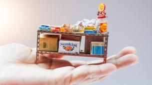 Miniature shelves full of snacks