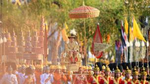 Thailand's King Maha Vajiralongkorn is carried in a golden palanquin during the coronation procession in Bangkok on May 5