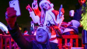 Revellers take a selfie in the annual SantaCon event in Manhattan, New York, December 10, 2016.