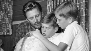 Kirk Douglas with sons Joel and Michael in 1956
