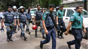 Security personnel are seen near the Holey Artisan restaurant hostage site, in Dhaka, Bangladesh, 2 July 2016.