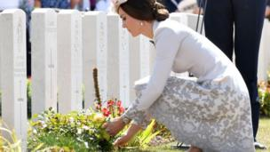 The Duchess of Cambridge laying flowers