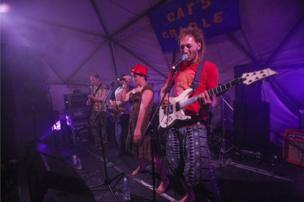 """The Hat Club bring their """"electric, eclectic, dubbed-up, ska-funked, gypsy-jazzed mash-up"""" to the Cat's Cradle stage on the opening night of the Sunrise Celebration festival, which ended in the early hours of Monday morning."""