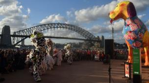 Lion dancers perform in front of the Sydney Harbour Bridge and Opera House at the start of the Lunar New Year Festival in Australia on February 16, 2018.