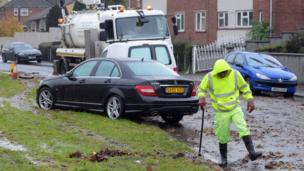 The clean up begins in Whitchurch Lane, Bristol