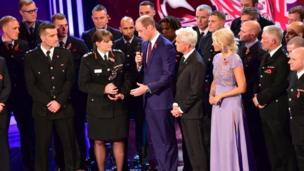 London Fire Brigade receive the This Morning Emergency Services Award from the Duke of Cambridge (centre), Holly Willoughby and Phillip Schofield