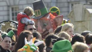 Can you spot the leprechaun in the Belfast crowd?