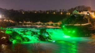 Rhine Falls, near Zurich, Switzerland, were bathed in green
