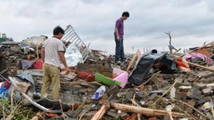 "Residents look for belongings in the rubble of a destroyed home in Funing county in Yancheng city in eastern China""s Jiangsu Province Friday, June 24, 2016."