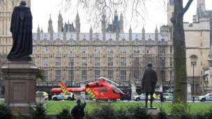 An air ambulance helicopter lands in the centre of Parliament Square