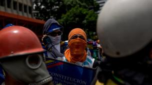 Protesters with a mock-up of the Venezuela constitution