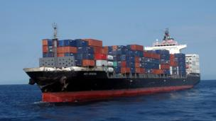 A handout photo made available by the 3rd Regional Coast Guard Headquarters shows the damaged container ship ACX Crystal