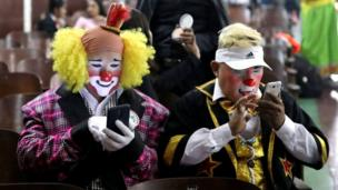 Clowns use their mobile phones during Peru's Clown Day celebrations in Lima, Peru May 25, 2018