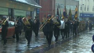 In Bangor, marching bands braved the rain to pay their respects