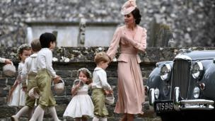 Duchess of Cambridge walks with the flower boys and girls