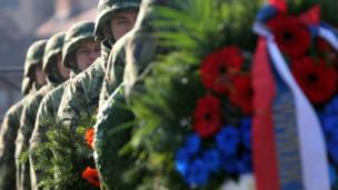 Members of a Serbian military honour guard prepare for a wreath laying ceremony at the French military cemetery during the Armistice Day commemorations marking the end of World War I, in Belgrade, Serbia, 11 November 2017
